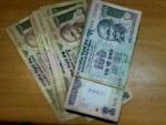 Rupee opens at 59.93 per dollar