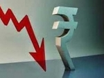 Indian Rupee down 14 paise against USD