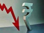Rupee down 12 paise against USD