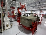 Tesla in advanced talks with five states to set up operations in India : Report