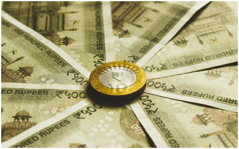 Rupee rises 7 paise against USD