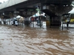 Heavy rains disrupt normal life in Mumbai, train service badly hit