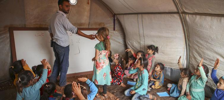 Teachers need more training to support traumatized refugee and migrant students, says UN on World Refugee Day