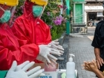 World can save lives and 'end this pandemic, together': WHO chief
