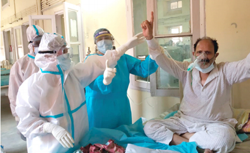 Jammu and Kashmir: Nursing staff in PPE kits dance with Covid-19 patients at SMGS Hospital