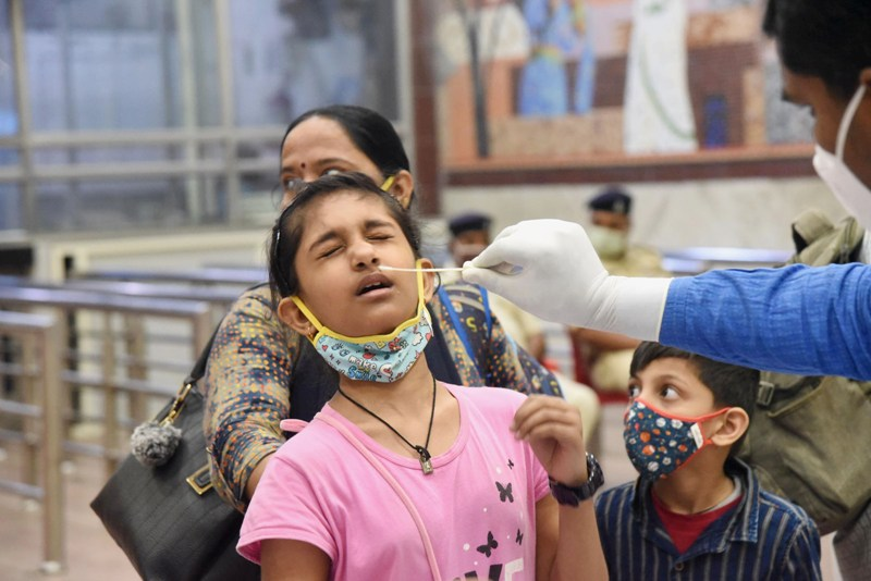 India records slight spike in COVID-19 cases, 497 people die