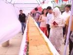 Nukkadwala makes world's longest vada pao, measuring 145 feet