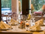 People eat more when dining with friends and family: Study