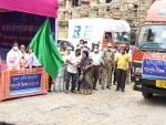 Assam Education Minister flags off free textbook carrying vehicles for Class 12 students