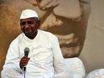 Anna congratulates Kejriwal, slams Modi