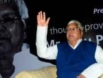 Lalu slams PM, says Modi trying to hide behind veil of cashless economy