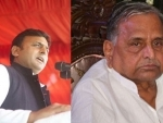 Father and son trade blow at SP meeting, but Mulayam says Akhilesh won't be removed as UP CM