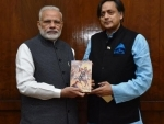Shashi Tharoor presents copy of his book to PM