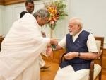 Women,  children tie Rakhi on PM's wrist on the occasion of Raksha Bandhan