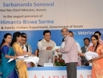 Sonowal distributes cheques to beneficiaries of Atal Amrit Abhiyan