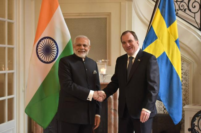 Narendra Modi interacts with Sweden PM Stefan Löfven