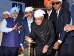 Ex-President Pranab Mukherjee unveils Bengali version of the Holy Guru Granth Sahib and Babuji's Biography
