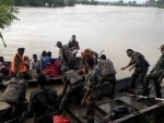 Indian army, Assam Rifles personnel rescue villagers in flood-hit Dimapur in Nagaland