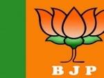 Oppositions complaint to EC over 'BJP' been written under lotus symbol on EVMs
