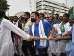 RJD protests against fuel price hike, Tejashwi attacks Modi govt