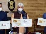 LG Sinha releases special covers on Kangri, Kehwa by Dept of Posts