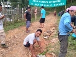 Assam Rifles assists villagers to repair road in Nagaland's Peren district