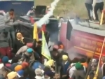 Farmers clash with police in march to Delhi against farm laws, tear gas used