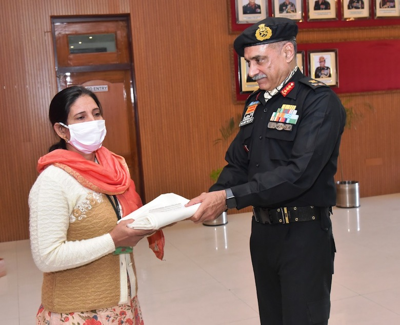 Smt Sudesh, one of the first beneficiaries of Naman receiving Naman cement release order from Lt Gen Alok Singh Kler, PVSM, VSM, GOC-in-C, Southern Western Command, Indian Army