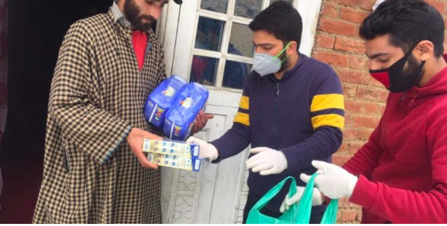 Covid-19: Shopian youth distributes food items, medicines to people in need