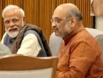 Amit Shah congratulates PM Modi on completing 20 years of public service