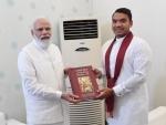 Sri Lankan Minister hands first copy of Sinhala-Tamil translation of Bhagavad Gita to PM Narendra Modi