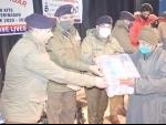 Jammu and Kashmir: Police distributes COVID safety kits among needy families