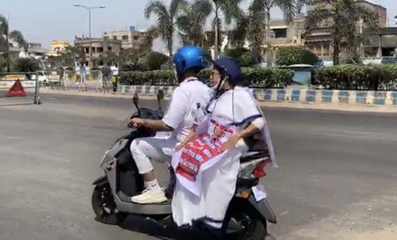 Mamata Banerjee travels in electric scooty to Nabanna protesting fuel price hike