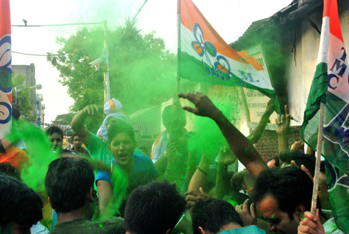 TMC supporters celebrate in front of CM's residence