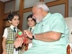 Women, children tie Rakhi on PM's wrist on Raksha Bandhan