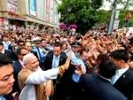 Modi interacting with the people near the Da Xing Shan Temple