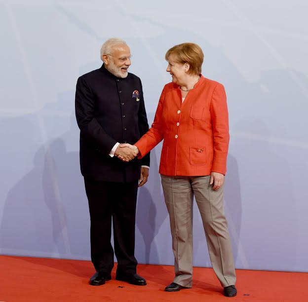 Narendra Modi being welcomed by the German Chancellor