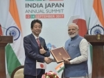 Narendra Modi and the Prime Minister of Japan,Mr.Shinzo Abe in a group photograph with the members of India-Japan Business Leaders Forum