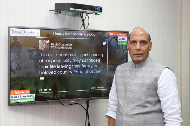 Rajnath Singh presenting a cheque to the Union Home Secretary