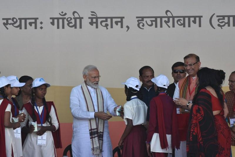 PM Modi provides milk packets to schoolchildren