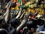 People gather in large numbers at temple for Maha Shivaratri