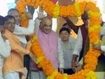 Amit Shah with Vijay Rupani at Plantation Drive and flagging off of vehicles in Ahmedabad