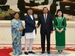 Cambodian Prime Minister Samdech Techo Hun Sen shakes hands with Nepalese Prime Minister K.P. Sharma Oli