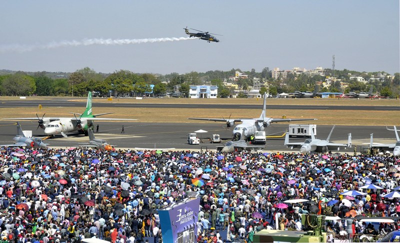 Visitors witness the last day of Aero India Show