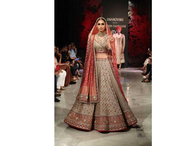 Models walk the ramp for Tarun Tahiliani's show