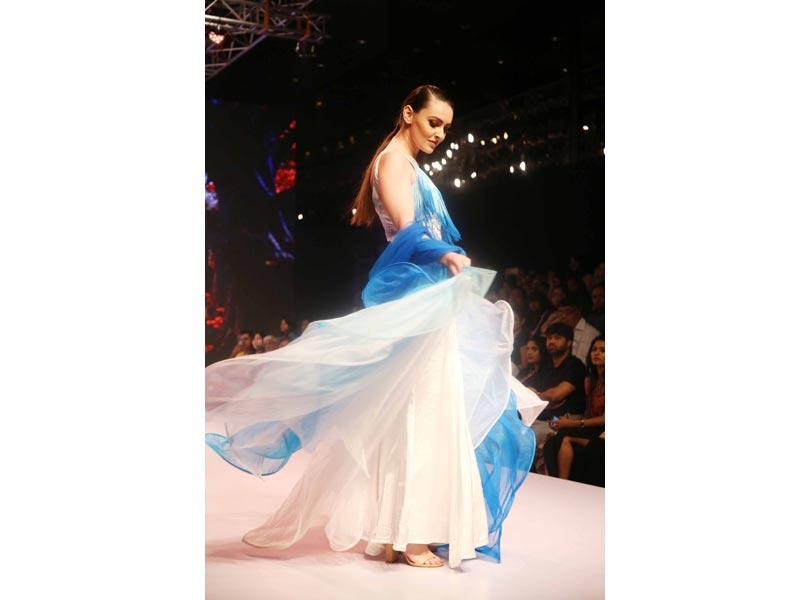 Models walk the ramp at fashion show in New Delhi