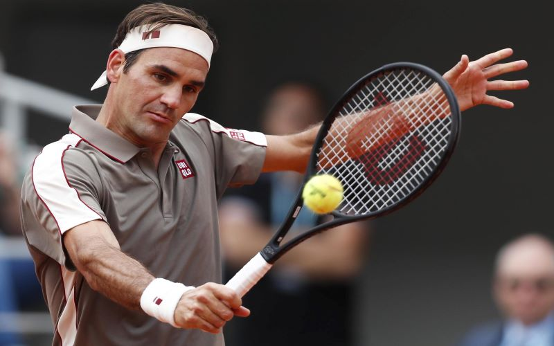 Roger Federer hits return at French Open in Paris