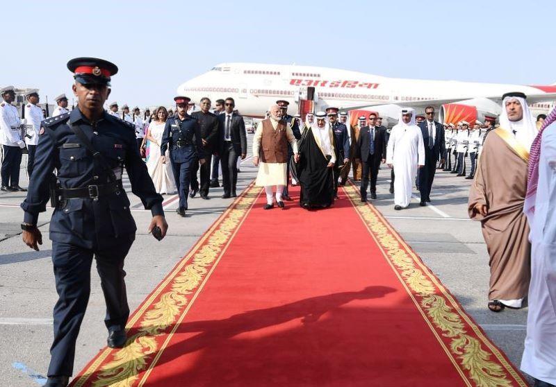 PM Modi received by Bahrain PM HH Prince Khalifa Bin Salman Al Khalifa in Bahrain