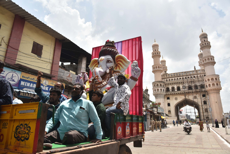 Hyderabad: Devotees on a truck passing through Charminar