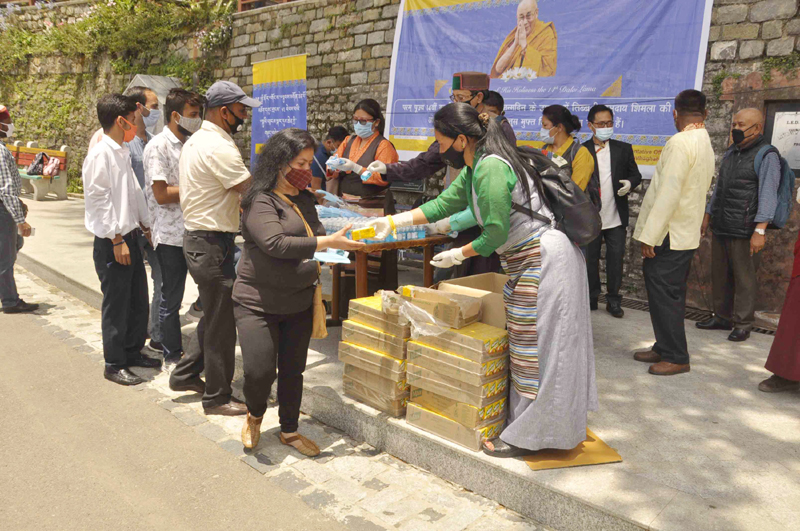 Shimla: Dalai Lama followers distribute masks, sanitizers and juice